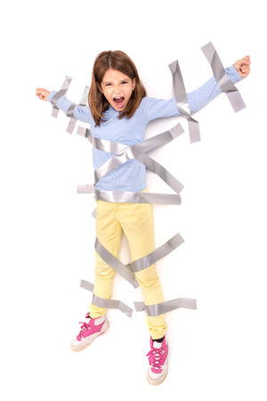 to restrain: Young girl tied to the wall with duct tape