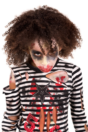 Young girl Zombie with face-paint in Halloween isolated in white