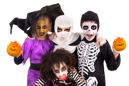 halloween kids: Kids with face-paint and Halloween costumes isolated in white