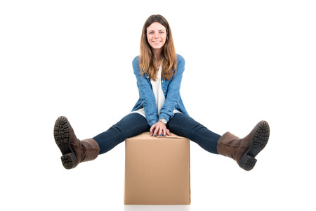 unpacking: Beautiful girl with cardboard boxes unpacking in new home Stock Photo