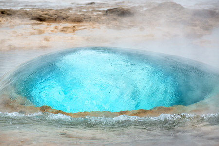 extreme heat: Strokkur geysir bubble ready to blow, Iceland in June
