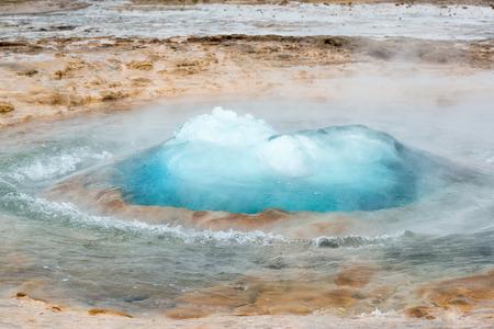 erupt: Strokkur geysir bubble ready to blow, Iceland in June