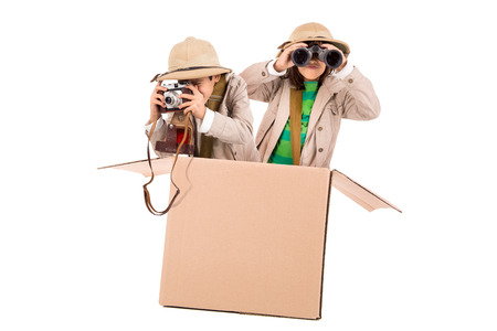 Children's couple in a cardboard box playing safari
