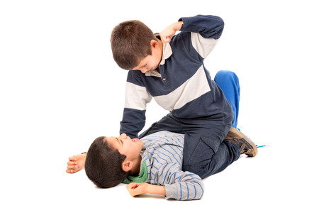 Young boys fighting isolated in white Stock Photo