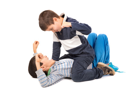 bullying: Young boys fighting isolated in white Stock Photo