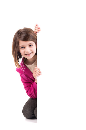 Young girl posing with a white board