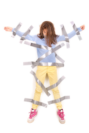 restrain: Young girl tied to the wall with duct tape