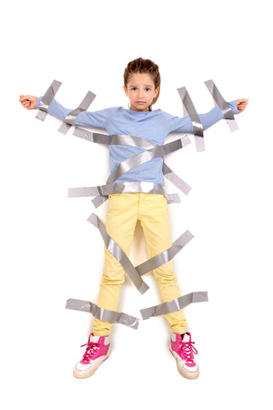 duct: Young girl tied to the wall with duct tape