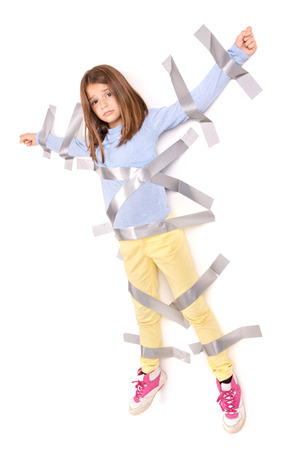 Young girl tied to the wall with duct tape