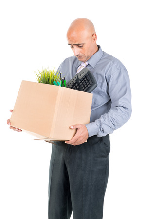 belongings: Fired worker with cardboard box with his belongings