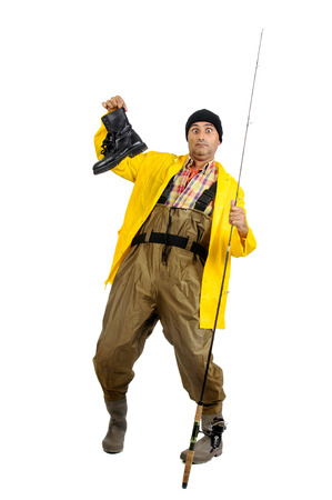 fishingpole: Fisherman with fishing rod and old boot isolated in white Stock Photo
