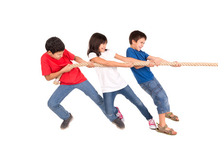 Group of children in a rope-pulling contest photo