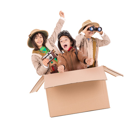 Children in a cardboard box playing Safari