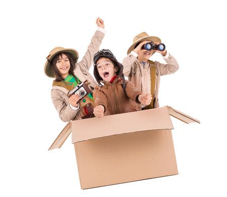 Children in a cardboard box playing Safari