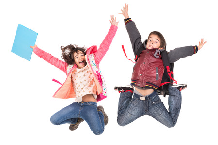 Young students couple  jumping isolated in white