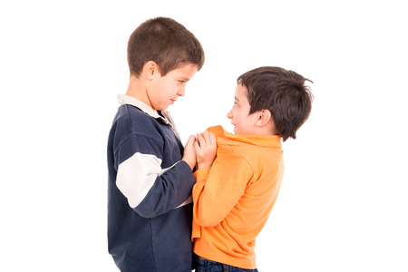 Bigger boy bullying a smaller one isolated in white Stock Photo