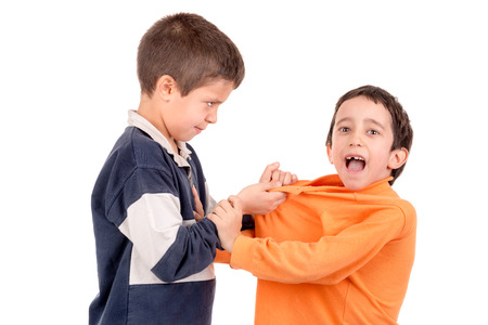 smaller: Bigger boy bullying a smaller one isolated in white Stock Photo