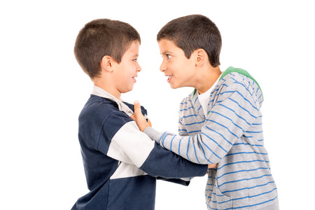 fight: Young boys fighting isolated in white Stock Photo