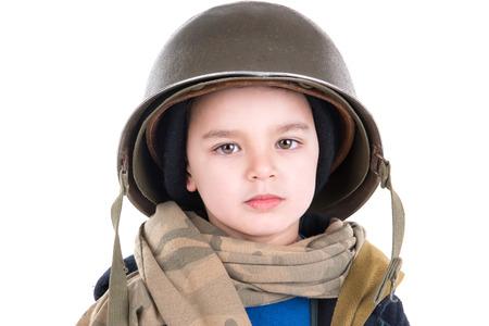 sad person: Young boy soldier portrait