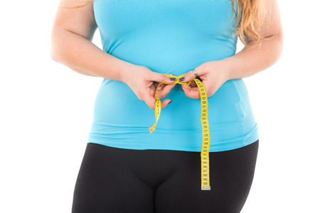 large girl waist with measuring tape isolated in white