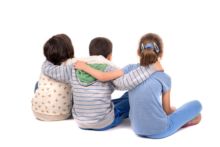 facing backwards: young children facing backwards isolated in white