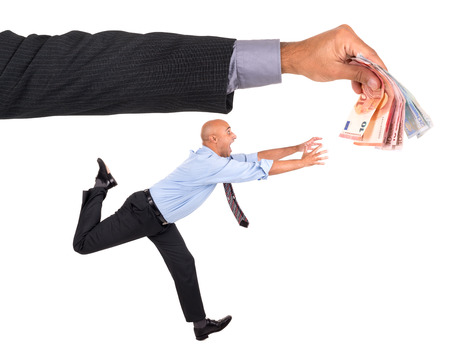 Businessman running with raised arms chasing money