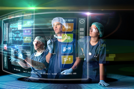 Doctors in a research station with digital  screens and keyboard 스톡 콘텐츠