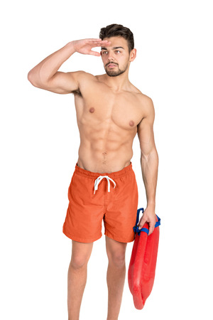 duty belt: Muscular lifeguard isolated in a white background Stock Photo