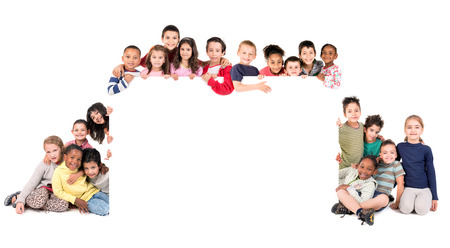 Group of children with a white board isolated in white