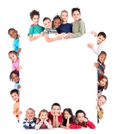 화이트 보드와 어린이의 그룹 흰색으로 격리 스톡 콘텐츠