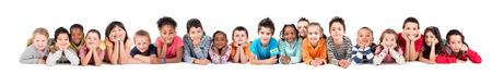 niño escuela: Gran grupo de niños posando aislado en blanco Foto de archivo