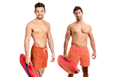 Muscular lifeguards isolated in a white background photo