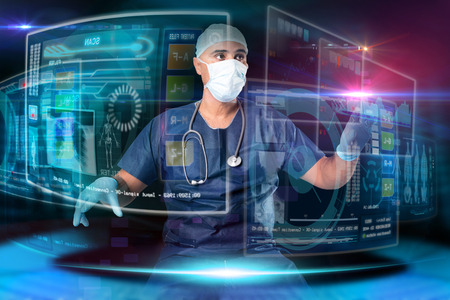 Doctor in uniform with digital  screens and keyboard