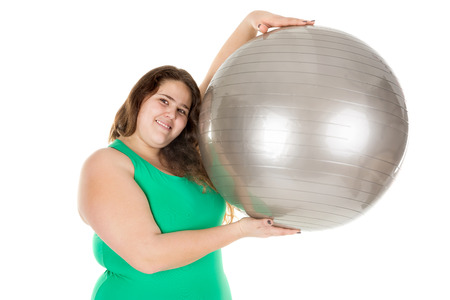 gluttonous: Beautiful large girl posing with an exercise ball isolated in white Stock Photo