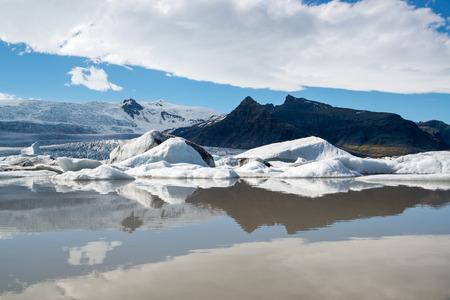 fjallsarlon: Reflections in Fjallsarlon lagoon, Iceland in June Stock Photo