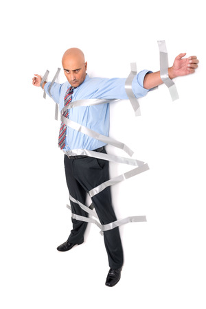 duct: Businessman glued to the wall with duct tape