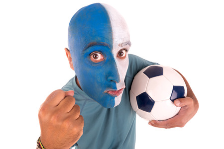 painted face: Football supporter with painted face with ball Stock Photo