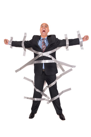 duct: Businessman screaming, glued to the wall with duct tape Stock Photo