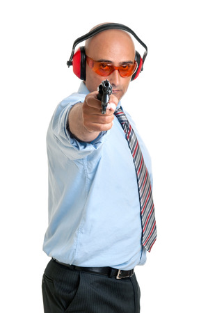 security laws: Man in shooting range with gun and goggles