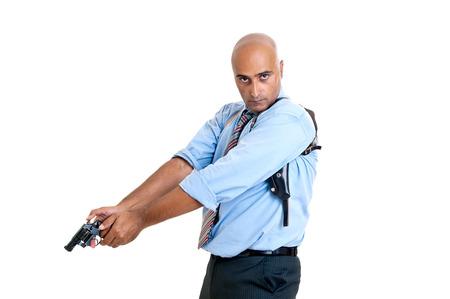 hombre disparando: Hombre disparando con pistola aislado en blanco Foto de archivo