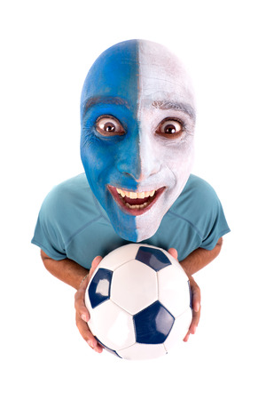 supporter: Football supporter with painted face with ball Stock Photo