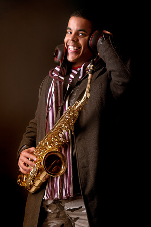 african sax: Stylish man playing the saxophone Stock Photo