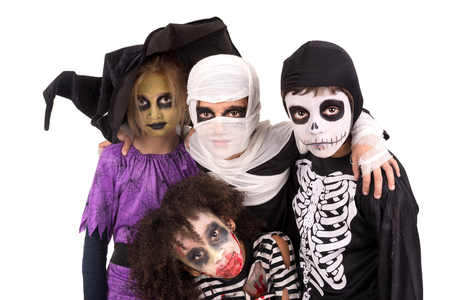 costumes: Kids with face-paint and Halloween costumes isolated in white