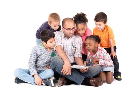 teacher: Group of children with teacher reading a story isolated in white