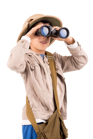 Young boy with binoculars playing Safari isolated in white Standard-Bild