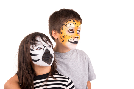 facial painting: Childrens couple with face-paint isolated in white