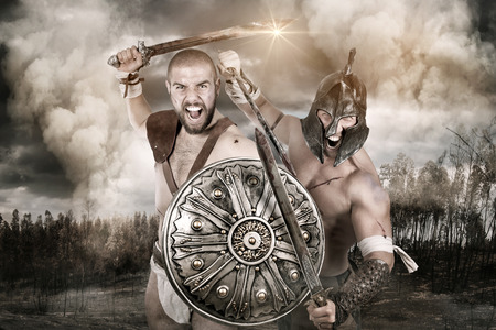 Ancient warriors in a battle in the forrest Stock Photo