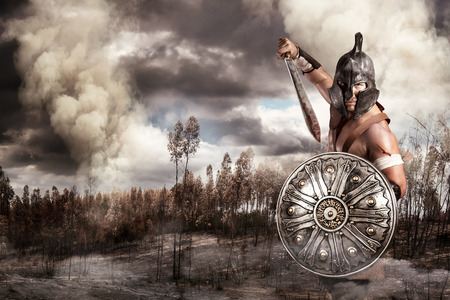warrior sword: Gladiator in a battle site in the mountains Stock Photo