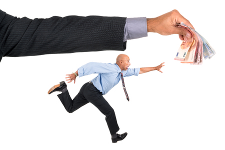 corporate greed: Businessman running with raised arms chasing money