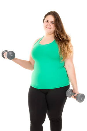 gluttonous: Beautiful large girl doing fitness exercises with dumbbells isolated in white Stock Photo